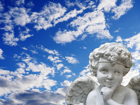 The cupid statue with the blue sky background