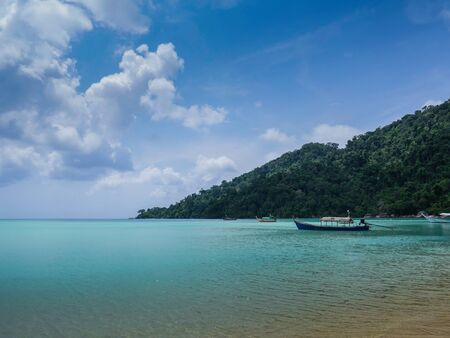 The travel boat in the blue sea and blue sky in asian