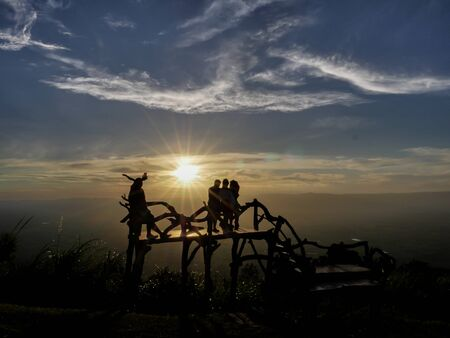 silhouette picture of family were traveling at the mountain on sunset time