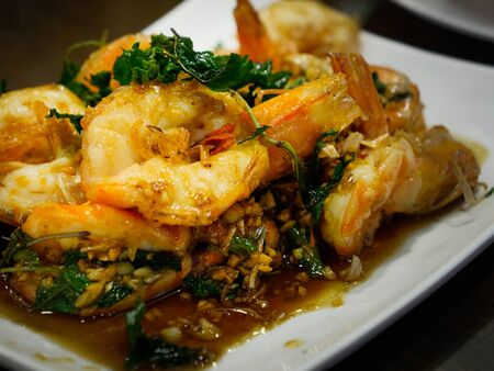 closeup picture of fried shrimp with chilli and Thai herb for serve on the dish Imagens