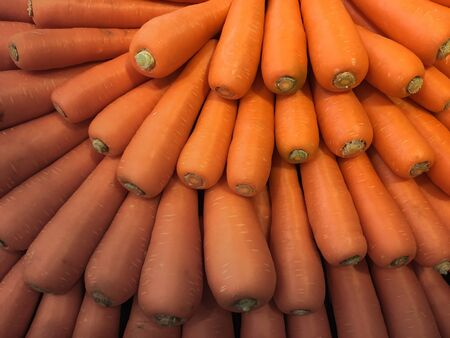 The orange carrot were sort in circle shape on the shelf for sell