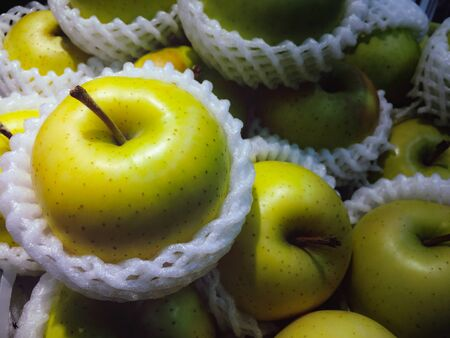 The gsroup of green apple were put in the basket for sell in the suppermarket