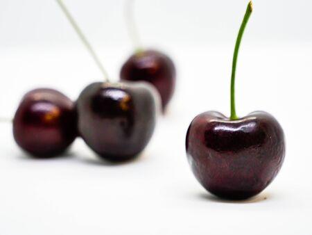 Isolated group of cherry fruit on white background Imagens