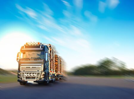 Heavy vehicle in logistics business was moving motion with sky background Imagens