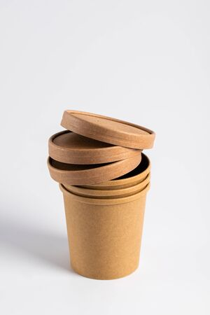 Empty paper soup cup on a white Imagens