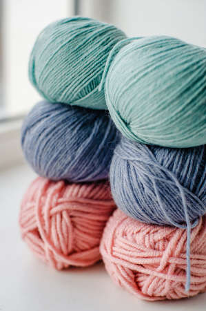 Multicolored skeins of wool yarn. Alpaca, Merino yarn. Threads for knitting and crocheting. Creativity and Hobbies