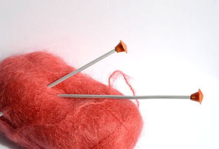 pastimes: skein of red yarn for knitting with spokes