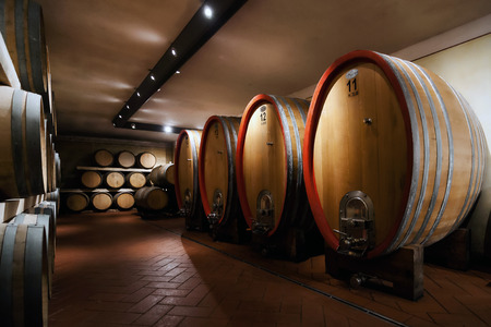 production area: Barrel - Some shots made in a basement, in the production area of Chianti, Tuscany, Italy  Are depicted oak barrels where the wine is fermented fine Stock Photo