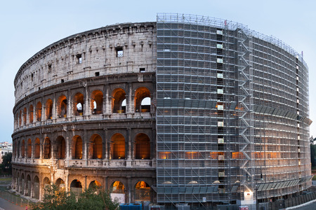 General view of the Colosseum with half of the body covered by scaffolding Stok Fotoğraf - 27945356
