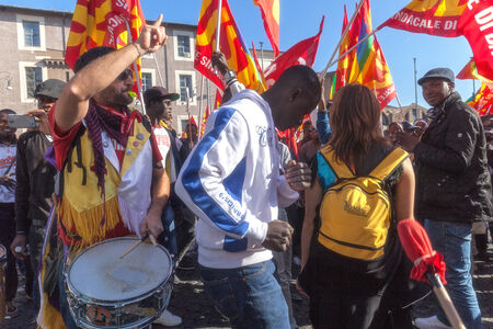 immigrants: Rome, Italy - November 14, 2014: Protest of immigrants of color, a group playing drums and dancing tribal dances.