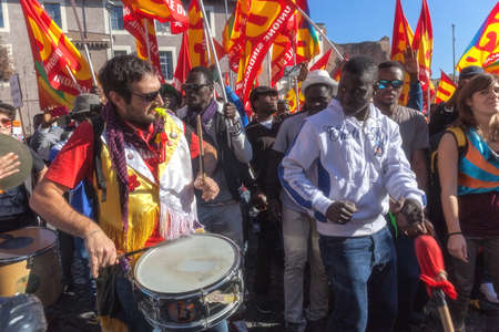 Rome, Italy - November 14, 2014: Protest of immigrants of color, a group playing drums and dancing tribal dances.