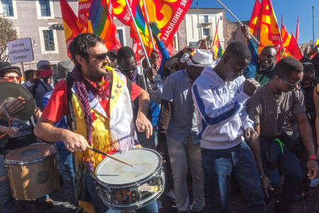 manifests: Rome, Italy - November 14, 2014: Protest of immigrants of color, a group playing drums and dancing tribal dances.