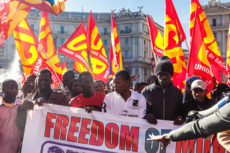 Rome, Italy - November 14, 2014: Protest of immigrants of color, Gathered in Esedra square and then marching in the streets of the capital.