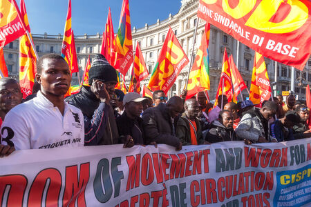 immigrants: Rome, Italy - November 14, 2014: Protest of immigrants of color, Gathered in Esedra square and then marching in the streets of the capital.