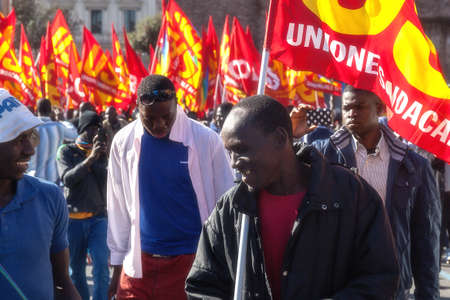 manifests: Rome, Italy - November 14, 2014: Protest of immigrants of color, Gathered in Esedra square and then marching in the streets of the capital.