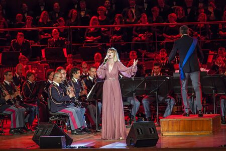 police state: Rome Italy 6 May 2015: Serena Autieri sings in the concert of the Band of the State Police.