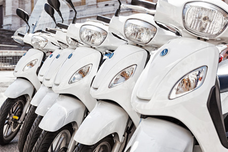 Series of white scooter parked in a row in the city. Stok Fotoğraf - 41254174