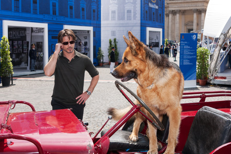 Rome Italy May 20 2011: The actor Ettore Bassi posing together at the German shepherd Nick Both Protagonists of the successful TV series