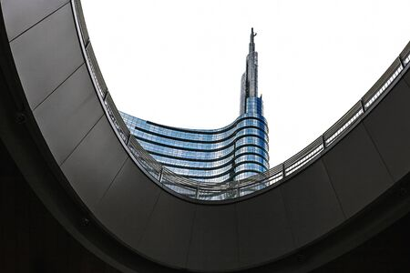 reverb: MILAN, ITALY - AUGUST 25, 2013: Architectural detail of the glass facade on the building in Milan Unicredit tower, the tallest skyscraper in Italy.