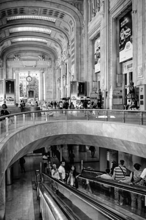 restructuring: Milan, Italy - August 26, 2013: The lobby of the main station in the new restructuring, with the escalator downstairs.