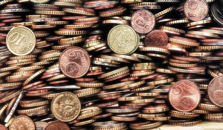 homogeneous: Coins of various countries piled one on the other form a homogeneous composition. Metals of different colors.