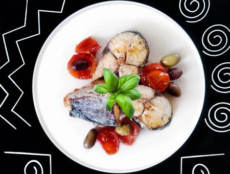blue fish: Blue fish cooked in a pan with olive oil, tomatoes and olives.