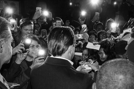 Rome, Italy - 15 January 2016: In the image Leonardo DiCaprio signs autographs to the public in the street. The actor is surrounded by Italian fans and the security men. We are in a public place, before it enters the red carpenter that will take him to th Editöryel
