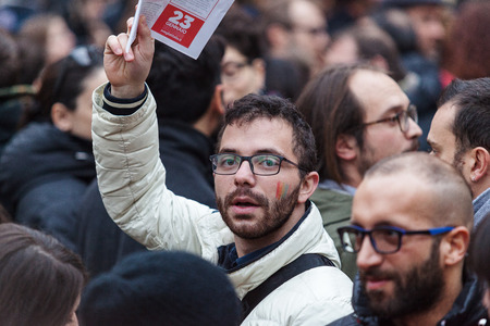 civil rights: Rome, Italy - 23 January 2016: Svegliatitalia, demonstration in Piazza della Rotonda in favor of the civil rights of homosexual couples. In the scene, one of the protesters is a sign of greeting, holding the flyer of the event.