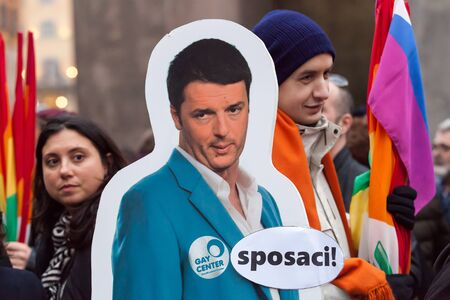 resumed: Rome, Italy - 23 January 2016: Svegliatitalia, demonstration in Piazza della Rotonda in favor of the civil rights of homosexual couples. In the scene, protesters resumed beside a giant poster of Prime Minister Renzi.