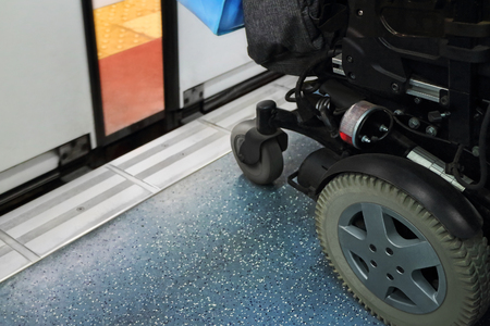 limp: Wheelchair waiting for the doors to open on the subway.