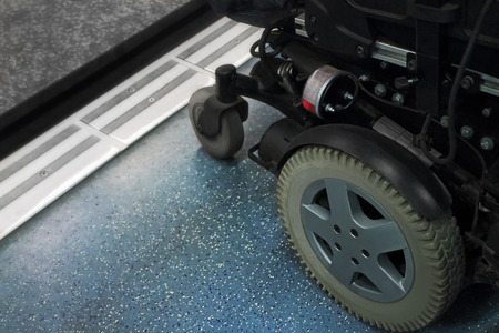 disablement: Wheelchair waiting for the doors to open on the subway.