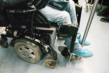 disablement: Rome, Italy - 21 January 2016: Disability in wheelchair on a subway car.