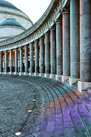 plebiscite: Piazza del Plebiscito in Naples. Perspective of the colonnade surrounding the square in half, in the background, the royal basilica of Saint Francis of Paola. Stock Photo