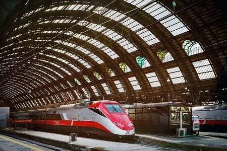 highspeed: Milan, Italy - August 26, 2013: Some of the high-speed trains on the tracks, before leaving the Central Station.