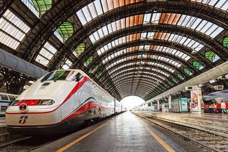 eurostar: Milan, Italy - August 26, 2013: high speed train White Arrow, stopped on a track to Milan Central Station. Editorial