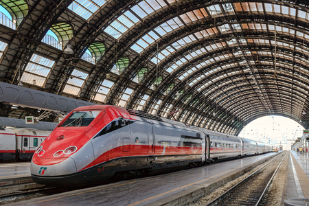 red arrow: Milan, Italy - August 26, 2013: high speed train Red Arrow, stopped on a track to Milan Central Station. Editorial