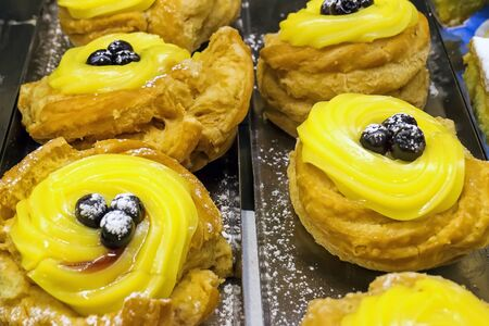 zeppola: Traditional Neapolitan pastry, is mainly consumed on the day of St. Joseph and the Easter holidays. fried grilled or baked. Stock Photo
