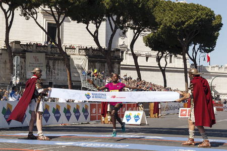 increased: Rome, Italy - April 10, 2016: Rahma Tusa during Rome Marathon 2016. The winners of the marathon in Rome 2016, Kenyan Amos Kipruto was the first to cross the finish line with a time of 2h0812 ahead of Ethiopian Birhanu Adane (2h0927) and Tujuba Megersa Editorial