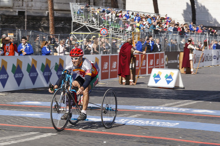 test passed: Rome, Italy - April 10, 2016: An athlete in hand bike race arrives at the finish line and cheers for the challenging test passed. Editorial