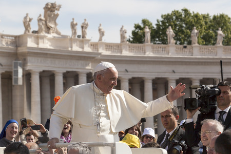Rome, Italy - April 30, 2016: Pope Francis on board for ships of the Pope-mobile runs through St. Peter's Square waving to the crowd around him on the occasion of the day dedicated to the jubilee of the military family and police.