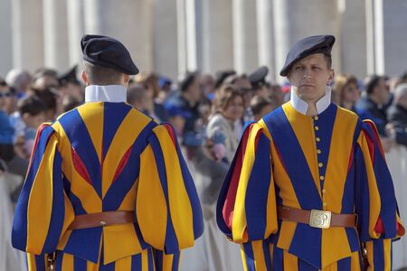 st  peter's square: Rome, Italy - April 30, 2016: Swiss Guards, with their colorful uniform feature, lined up in St. Peters Square, in the general audience of the Pope. Editorial