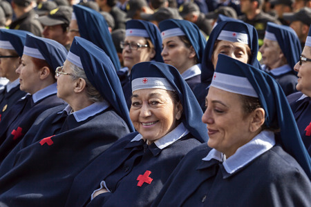 deployed: Rome, Italy - April 30, 2016: Women of the Red Cross volunteers deployed in St. Peters Square, on the occasion of the day dedicated to the jubilee of the military family and the police. Editorial