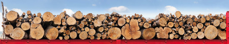 transported: Tree trunks stacked in a row on a red truck, ready to be transported. Horizontal four images side by side, light blue background of sky and clouds. Stock Photo