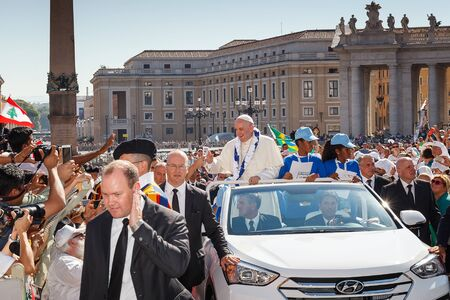 Vatican, Italy - September 3, 2016: Pope Francis on the new mobile pope, surrounded by a crowd of faithful in St. Peters Square. Editorial