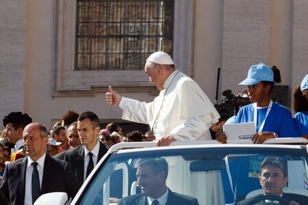 cassock: Vatican, Italy - September 3, 2016: Pope Francis on the new pope mobile, waving to the crowd of faithful gathered in St. Peters Square, for the sanctification of Mother Teresa of Calcutta. Editorial