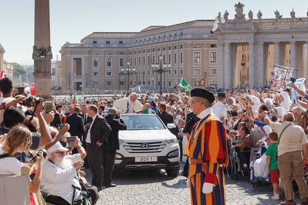 fondle: Vatican, Italy - September 3, 2016: Pope Francis on the new mobile pope, surrounded by a crowd of faithful in St. Peters Square. Editorial