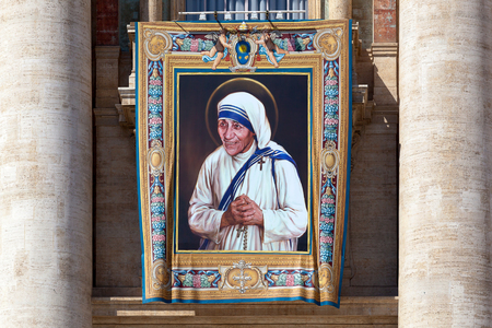Mother Teresa: Rome, Italy - September 3, 2016: The painting exhibited on the facade of St. Peters Basilica, on the occasion of the beatification of Mother Teresa of Calcutta.