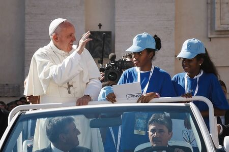Mother Teresa: Vatican State - September 3, 2016: Pope Francis on the new convertible car, waving to the crowd of faithful gathered in St. Peters Square for the sanctification of Mother Teresa of Calcutta.