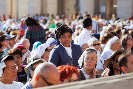 Mother Teresa: VATICAN - September 3, 2016: Faithful present in St. Peters Square, during the celebrations for the sanctification of Mother Teresa of Calcutta. At the center, a nun looks straight into the camera that takes up at that time.