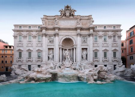 The famous Trevi fountain seen from the front. daylight photography with natural light, long exposure to highlight the movement of the water falls. Stock Photo